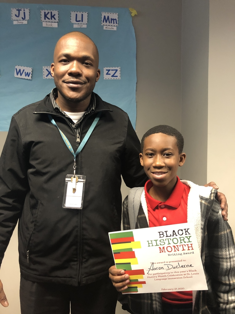A winning student from our poetry contest and his teacher.